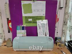 Cricut Explore Air 2 Cutting Machine Mint with pens and weeding tools